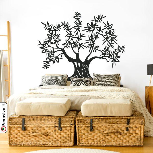 Testata letto da parete a forma di albero di olivo realizzata in metallo